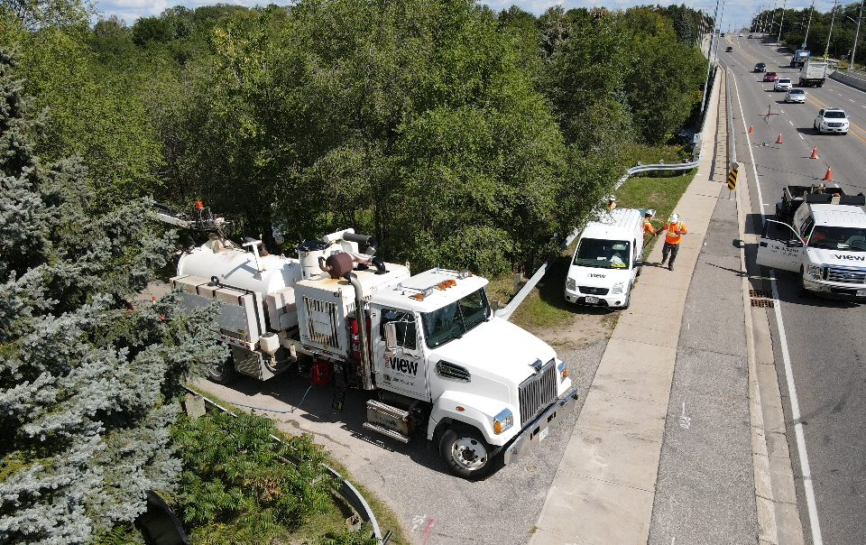 Aerial view of Vacuum Excavation Truck at side of roadway.