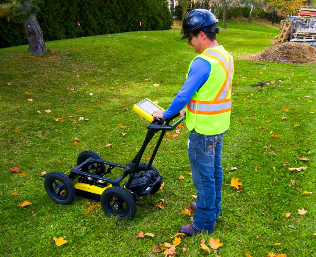 Senior Geophysicist Evelio Martinez searches for non-conductive utilities using Ground Penetrating Radar (GPR).