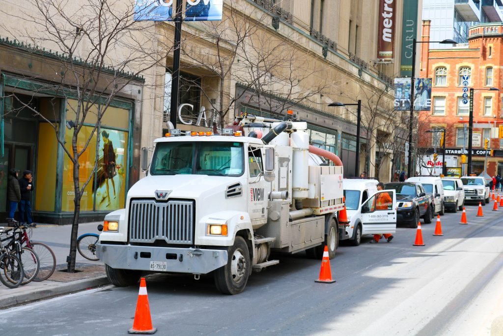 Performing Vacuum Excavation on Yonge Street in Toronto. We use the latest equipment, designed for tight urban access. Our services are tailored to accommodate unique project site conditions, and we offer both hydro and pneumatic excavation.