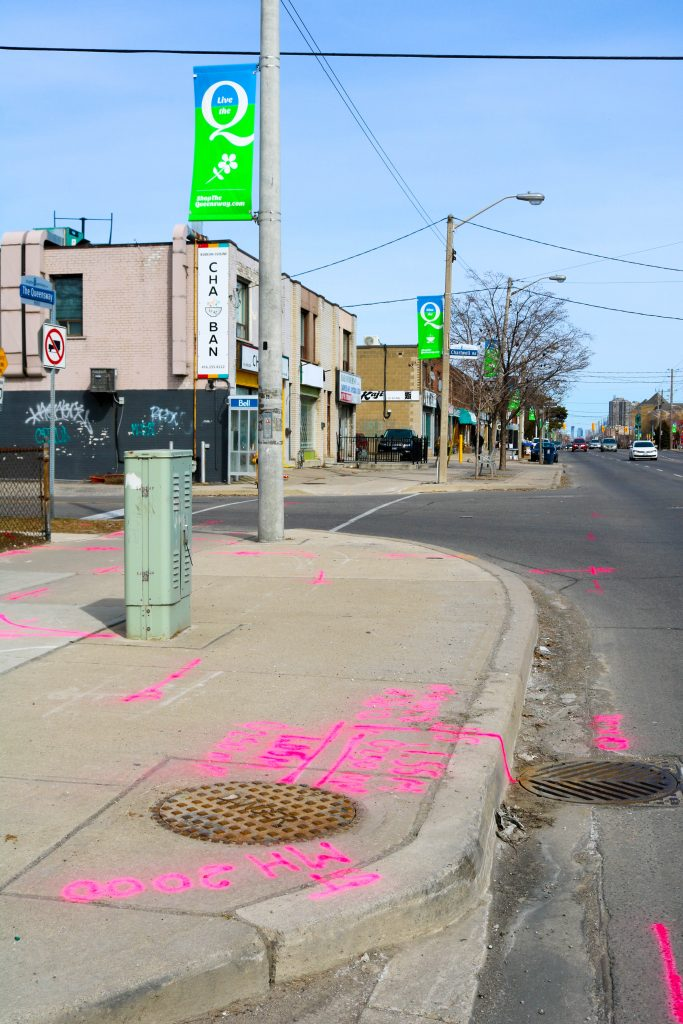 Pink paint denotes markings related to a Subsurface Utility Engineering (SUE) project. SUE provides critical data to inform engineering design.