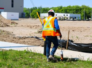 Informative Image of a Career at multiVIEW. This photo showcases an Experienced Utility Locator Technician working safely in summer heat.