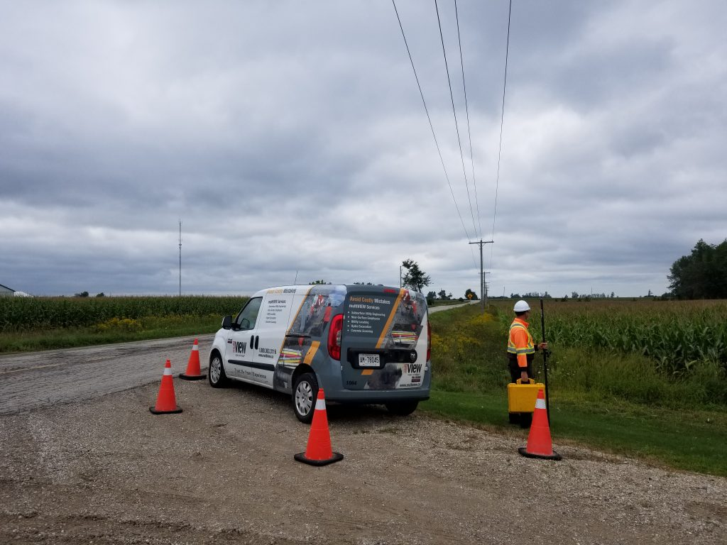 Locating utilities in St. Jacobs Ontario on a stormy afternoon.