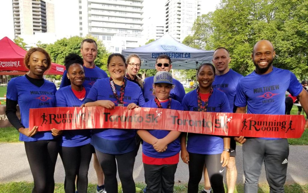 Informative Image of a multiVIEW Corporate Social Responsibility initiative. This photos shows ten multiVIEW employees participating in the Toronto 5K Run to raise funds for the SickKids Foundation.