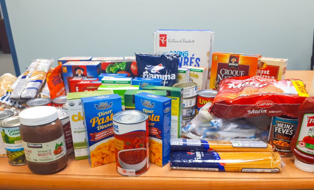 Informative Image of a multiVIEW Corporate Social Responsibility initiative. Image displays the variety of non-perishable food items collected during multiVIEW's corporate food drive and donated to the Mississauga Food Bank during the holiday season.