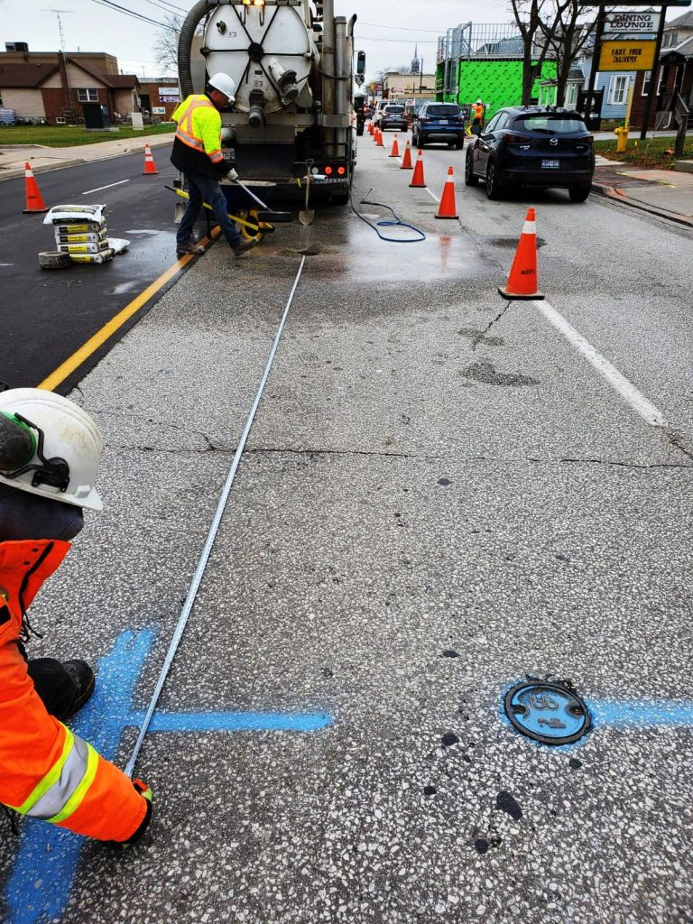 The multiVIEW team marks water utilities along a major roadway.